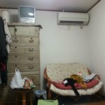 sofa in room, also has 2 heaters
