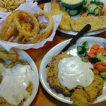 A delicious meal! Onion rings, fried catfish, chicken-fried steak, steamed veggies, mac and chee