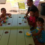 Kids enjoying their shaved ice with tables made to hold their cups!