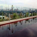 rooftop red-tiled pool with sweeping city views