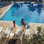 Swimming pool being cleaned by owner and daughter
