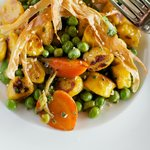 Roasted carrot gnocchi, thumbelia carrots, English peas, carrot vinegar, roasted benne seeds