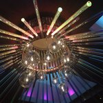 Beautiful chandelier in the casino near one of the escalators