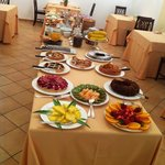 An extensive breakfast is set up in this room every day, with personlized coffee/cappucino/espre