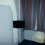Television in room - wall mounted due to sloping coombes in room