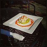 Fresh jumbo lump crabmeat served over guacamole with a strawberry - mango coulis. Topped with a