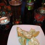 garlic bread is free. beer is not :)