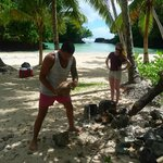 Charles the Samoan trying to open a coconut for us on a Lynn's getaway outing