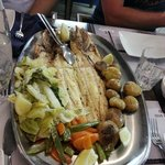 Delicious seabass, potatoes, carrots and salads
