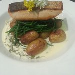 Salmon fillet, samphire, new potatoes,  locally sourced sorrel sauce and edible flowers