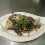 Locally foraged wild garlic with wild mushrooms on artisan bread spread with chicken liver pate