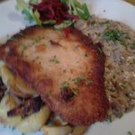 Schnitzel with fried potatoes and mushroom sauce
