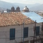 Lovely view of Cusco over roof of adjoining building.