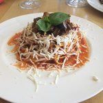 Pasta with eggplant, fresh tomato sauce and salted ricotta