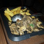 Fries and mushrooms which came with the pork ribs