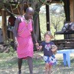 With Masai staff