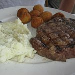 12 oz. Rib-eye steak with mashed potaotes and hush puppies