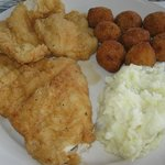 Fried chicken dinner with mashed potatoes and hush puppies