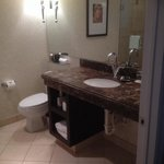 Beautiful bathroom with marble countertops and very nice tile flooring
