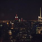 the view at night with the Empire state in the middle