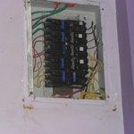 exposed wiring under leaking roof