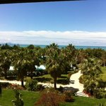 A room with a view over the swimmingspool, gardens and the sea!