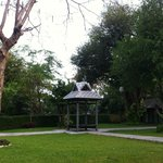 The hotel park and a gazebo for relaxing.