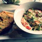 Ravioli, basil cream pesto sauce, cherry tomato, spring onion