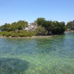 One of the few coral islands beyond the shore - most are mangroves.