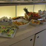 fruits and joghurt, various jams for breakfast