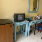 Fridge and TV in the room