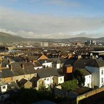 Dusk falling across Belfast