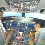 Brian and his daughter in the 737 simulator in Mumbai