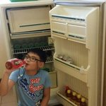 Family room. Refridgerator filled with bottled waters, juices and sodas from 20-55 pesos.