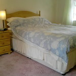 Nook Cottage double bedroom with view of garden, seatting area and poultry