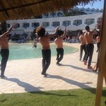 Boys with there tops off :) doing a show by the pool for new arrivals :)