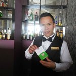 Presenting bartender Juan a TripAdvisor service pin - he was excellent!