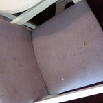 stained up chair with burn holes in a non smoking room had to place towls on them just to fell c
