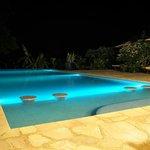 Masada Kep / Pool area at night