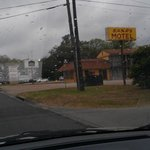 amusing sign of almost next door hotel, w sign on property advertising the best western hotel do