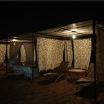 Roof cabanas at night very exotic and private