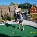 Fun family mini golf play