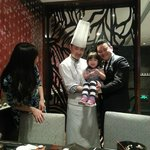 Eating dinner with the Chef and Manager stopping by to say hello.