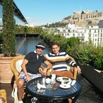 at the terrace having breakfast