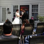 Rev. Marquart officiating a wedding on deck