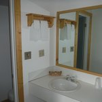 Full bathroom with shower and vanity