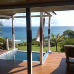 View from open living area of our bure. Notice dipping pool for cooling off with an adult bevera