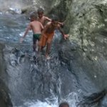 """Some local kids at the natural water slide. """"laco telly"""" (sp?) means """"do it again!"""" in Fijian"""