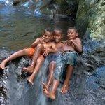 Local kids at natural water slide.