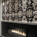 Artisitc Leather and Hide Design above Fireplace